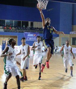 ONGC's star Vishesh Bhriguvanshi makes a layup against Bhiwani Club, Haryana